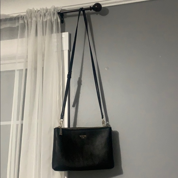 A black and silver authentic GUESS crossbody